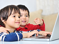 Boys using a laptop computer