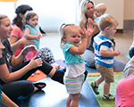 Toddlers dancing at a library event.