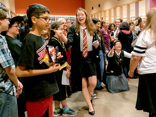 Teens celebrating at a library event.