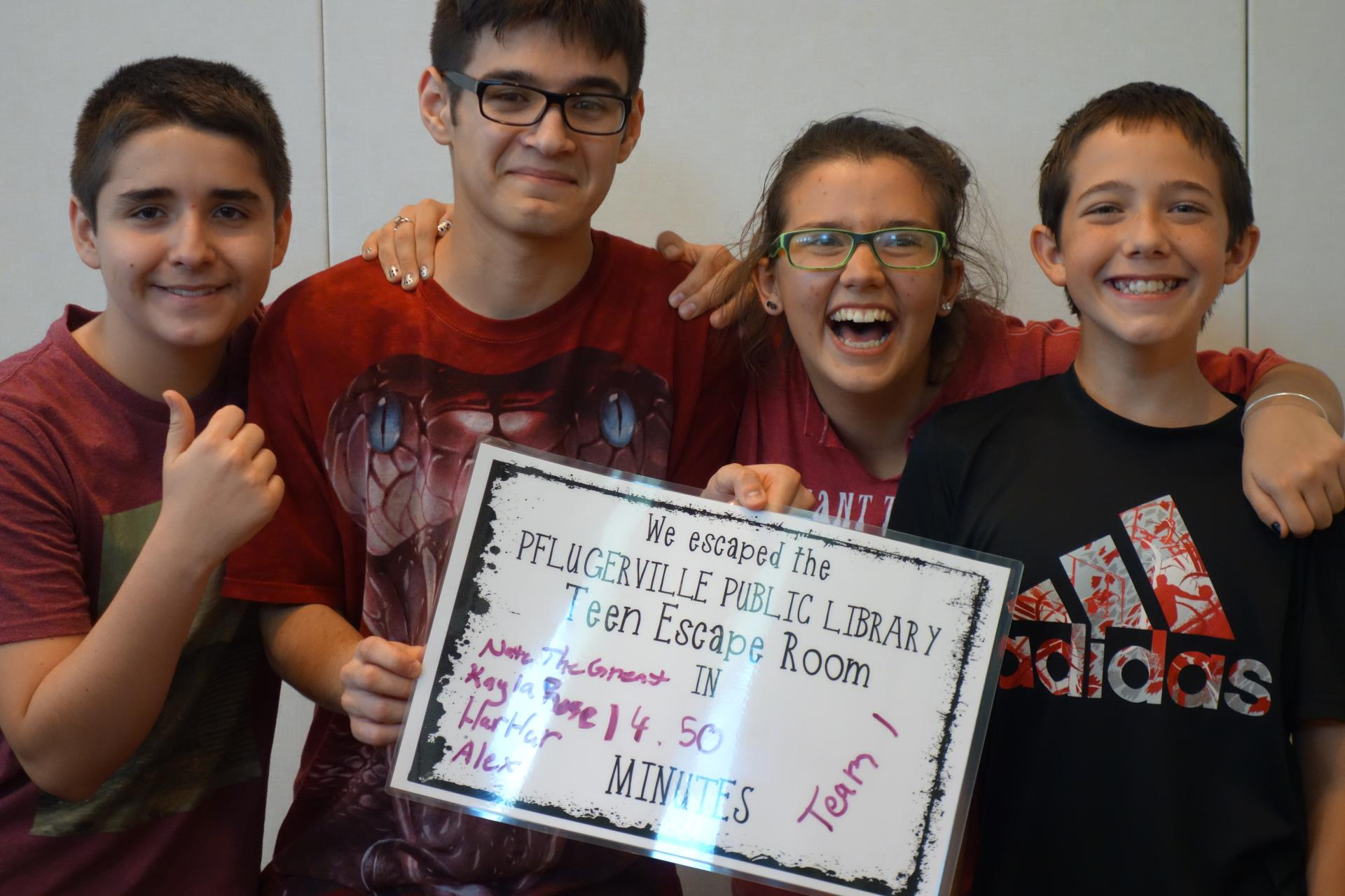 Teens celebrate their Escape Room success