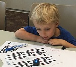 Child playing with Ozobot