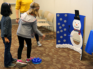 Girl playing snowman game at Winter Pfest